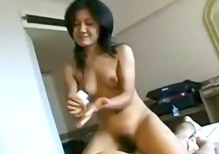 thai beauty giving massage riding on guy on the